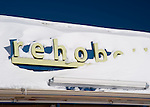 """Need I say more?  Snow drifts across the """"Rehoboth"""" sign (part of a store sign in Rehoboth Beach, Delaware, USA) the morning after the blizzard of February 2010."""