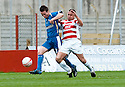 17/04/2010   Copyright  Pic : James Stewart.sct_jsp03_hamilton_v_kilmarnock  .::  GARRY HAY IS CHALLENEGD BY JAMES WESOLOWSKI ::  .James Stewart Photography 19 Carronlea Drive, Falkirk. FK2 8DN      Vat Reg No. 607 6932 25.Telephone      : +44 (0)1324 570291 .Mobile              : +44 (0)7721 416997.E-mail  :  jim@jspa.co.uk.If you require further information then contact Jim Stewart on any of the numbers above.........