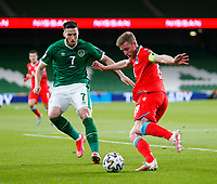 27th March 2021; Aviva Stadium, Dublin, Leinster, Ireland; 2022 World Cup Qualifier, Ireland versus Luxembourg; Laurent Jans (Luxembourg) tries to clear the ball under pressure from Matt Doherty (Republic of Ireland)