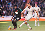 Karim Benzema (r) of Real Madrid competes for the ball with Jeremie Boga of Granada CF during their La Liga match between Real Madrid and Granada CF at the Santiago Bernabeu Stadium on 07 January 2017 in Madrid, Spain. Photo by Diego Gonzalez Souto / Power Sport Images