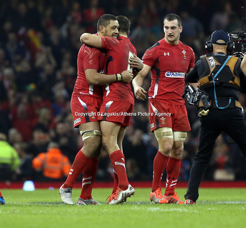 Pictured L-R: Taulupe Faletau of Wales hugs team mate Rhys Webb, watche on by team captain Sam Warburton after the final whistle Saturday 29 November 2014<br /> Re: Dove Men Series 2014 rugby, Wales v South Africa at the Millennium Stadium, Cardiff, south Wales, UK.