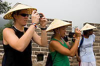 USWNT goalkeeper Nicole Barnhart composes a photo along with teammate Angela Hucles and Briana Scurry while climbing the Great Wall at Badaling near Beijing, China.  The team will spend a few days in the capital before moving to Qinhuangdao for their first two group games of the 2008 Olympics.