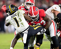 ATHENS, GA - NOVEMBER 09: Robert Beal Jr. #33 of the Georgia Bulldogs tackles Tyler Badie #1 of the Missouri Tigers during a game between Missouri Tigers and Georgia Bulldogs at Sanford Stadium on November 09, 2019 in Athens, Georgia.