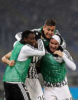 Calcio, quarti di finale di Coppa Italia: Lazio vs Juventus. Roma, stadio Olimpico, 20 gennaio 2016.<br /> Juventus' Stephan Lichsteiner, second from left, partially seen, celebrates with teammates, from left, Kwadwo Asamoah, Paulo Dybala and Simone Padoin after scoring during the Italian Cup quarter final football match between Lazio and Juventus at Rome's Olympic stadium, 20 January 2016.<br /> UPDATE IMAGES PRESS/Isabella Bonotto