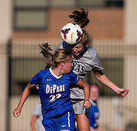 Marina Paul (5) of Georgetown goes up for a header with Ashleigh Goddard (23) of DePaul during the game at Shaw Field on the campus of Georgetown University in Washington, DC.  Georgetown tied DePaul, 1-1, in double overtime.