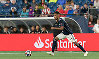 FOXBOROUGH, MA - JULY 17: Juan Agudelo #17 dribbles during a game between Vancouver Whitecaps and New England Revolution at Gillette Stadium on July 17, 2019 in Foxborough, Massachusetts.