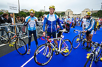 07 JUL 2012 - PARIS, FRA - Will Clarke (Lagardere Paris Racing) (centre) prepares for the start of the elite men's French Grand Prix round during the 2012 Triathlon de Paris at the Pont de Lena in Paris, France (PHOTO (C) 2012 NIGEL FARROW)