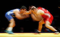 BELGRADE, SERBIA - MARCH 09:Long time exposure of Serdar Boke of Turkey (L) competes for the bronze medal with Gheorghita Stefan of Romania (R) of Men's Freestyle 84kg during the European wrestling championship March 09, 2011 in Belgrade, Serbia.(Photo by Srdjan Stevanovic/Getty Images)
