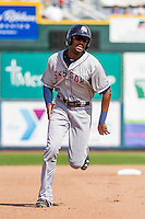 Colorado Springs Sky Sox outfielder Lewis Brinson (28) races toward third base during a game against the Iowa Cubs on September 4, 2016 at Principal Park in Des Moines, Iowa. Iowa defeated Colorado Springs 5-1. (Brad Krause/Four Seam Images)
