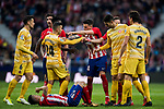 Jose Maria Gimenez de Vargas of Atletico de Madrid confronts with Borja Garcia Freire of Girona FC as Angel Correa of Atletico de Madrid lies injured on the pitch during the La Liga 2017-18 match between Atletico de Madrid and Girona FC at Wanda Metropolitano on 20 January 2018 in Madrid, Spain. Photo by Diego Gonzalez / Power Sport Images