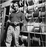 Black and white portrait of Patagonia founder Yvon Chouinard at factory in Santa Barbara, CA circa 1980s