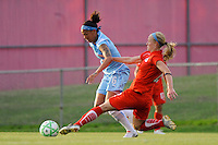 Becky Sauerbrunn (22) of the Washington Freedom goes in for a tackle on Natasha Kai (6) of Sky Blue FC. Sky Blue FC and the Washington Freedom played to a 4-4 tie during a Women's Professional Soccer match at Yurcak Field in Piscataway, NJ, on July 15, 2009.