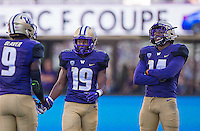 Husky defensive backs Jojo McIntosh and Brandon Lewis share a light-hearted moment after Brandon Beaver failed to secure a turnover late in the game.