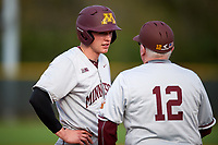 Minnesota Golden Gophers catcher Eli Wilson (4) talks with head coach John Anderson (12) during a game against the Boston College Eagles on February 23, 2018 at North Charlotte Regional Park in Port Charlotte, Florida.  Minnesota defeated Boston College 14-1.  (Mike Janes/Four Seam Images)