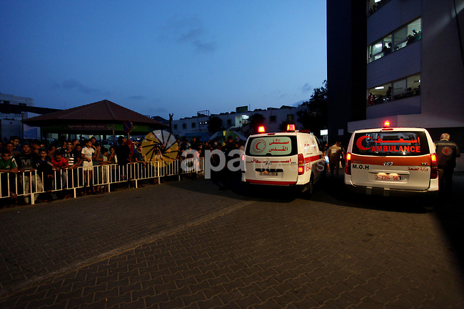 Ambulances which carry wounded Palestinian protesters arrives to al-Shifa hospital in Gaza city on October 19, 2018. Photo by Mahmoud Ajjour