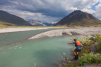 Fishing for Arctic char on the Marsh Fork of the Canning River, Arctic National Wildlife Refuge, Brooks Range mountains, Alaska.