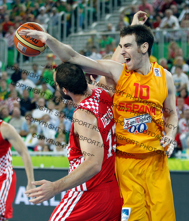 """Victor Claver of Spain (R) in action during European basketball championship """"Eurobasket 2013""""  basketball game for 3rd place between Spain and Croatia in Stozice Arena in Ljubljana, Slovenia, on September 22. 2013. (credit: Pedja Milosavljevic  / thepedja@gmail.com / +381641260959)"""
