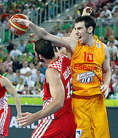 "Victor Claver of Spain (R) in action during European basketball championship ""Eurobasket 2013""  basketball game for 3rd place between Spain and Croatia in Stozice Arena in Ljubljana, Slovenia, on September 22. 2013. (credit: Pedja Milosavljevic  / thepedja@gmail.com / +381641260959)"