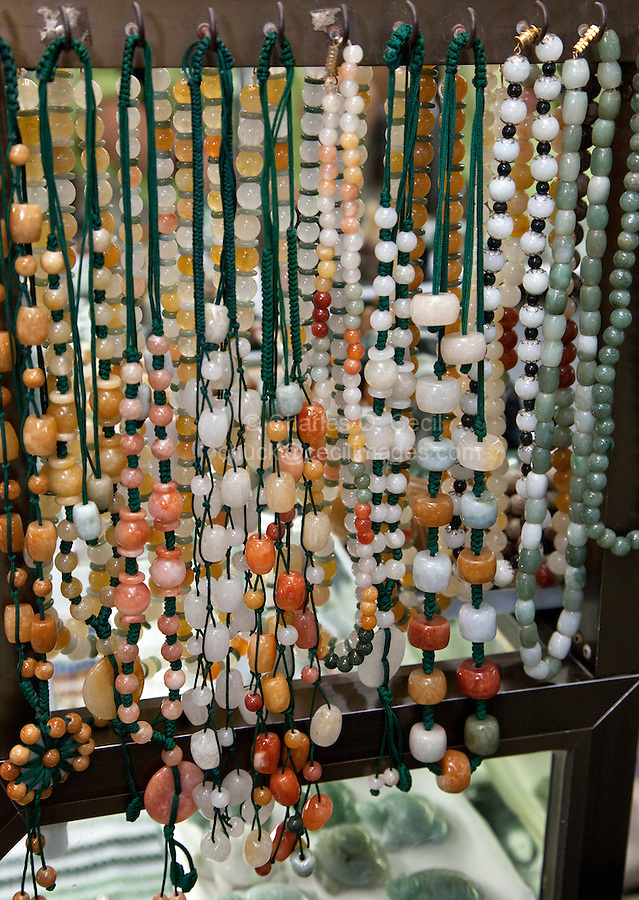 Myanmar, Burma, Yangon.  Necklaces of Jade and other Polished Stones.  Scott's Market.