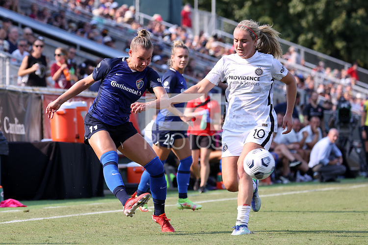 CARY, NC - SEPTEMBER 12: Merritt Mathias #11 of the North Carolina Courage crosses the ball past Lindsey Horan #10 of the Portland Thorns FC during a game between Portland Thorns FC and North Carolina Courage at Sahlen's Stadium at WakeMed Soccer Park on September 12, 2021 in Cary, North Carolina.