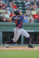Catcher Jonathan Morales (8) of the Rome Braves bats in a game against the Greenville Drive on Tuesday, August 30, 2016, at Fluor Field at the West End in Greenville, South Carolina. Greenville won, 7-3. (Tom Priddy/Four Seam Images)