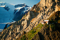 The Erie Mine bunkhouse perched high on the mountains above the Kennicott Copper Mill, the Root Glacier and Stairway Icefall in the background, Wrangell Saint Elias National Park and Preserve, Alaska