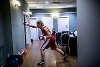 A female boxer prepares for a fight at the London Irish Centre where the 'Carpe Diem' white collar boxing event is taking place. <br /> <br /> 'White-collar boxing' is a growing phenomenon amongst well paid office workers and professionals and has seen particular growth in financial centres like London, Hong Kong and Shanghai. It started at a blue-collar gym in Brooklyn in 1988 with a bout between an attorney and an academic and has since spread all over the world. The sport is not regulated by any professional body in the United Kingdom and is therefore potentially dangerous, as was proven by the death of a 32-year-old white-collar boxer at an event in Nottingham in June 2014. The London Irish Centre, amongst other venues, hosts a regular bout called 'Carpe Diem'. At most bouts participants fight to win. Once boxers have completed a few bouts they can participate in 'title fights' where they compete for a replica 'belt'.