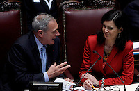 Il Presidente del Senato Piero Grasso parla col Presidente della Camera Laura Boldrini durante la terza seduta comune di senatori e deputati per l'elezione del nuovo Capo dello Stato alla Camera dei Deputati, Roma, 19 aprile 2013..Italian Senate President Pietro Grasso, left, talks to Lower Chamber President Laura Boldrini during the third common plenary session of senators and deputies to elect the new Head of State, at the Lower Chamber in Rome, 19 April 2013..UPDATE IMAGES PRESS/Isabella Bonotto