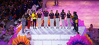 12 AUG 2012 - LONDON, GBR - Competitors present flowers to six volunteers, in a symbolic recognition of the contribution made by all the Games volunteers, during the London 2012 Olympic Games Closing Ceremony in the Olympic Stadium in the Olympic Park, Stratford, London, Great Britain (PHOTO (C) 2012 NIGEL FARROW)