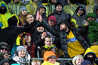 Fans high-five during the Super Rugby final match between the Hurricanes and Lions at Westpac Stadium, Wellington, New Zealand on Saturday, 6 August 2016. Photo: Dave Lintott / lintottphoto.co.nz