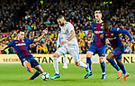 Karim Benzema (2nd from L) of Real Madrid vies for the ball with Sergio Busquets Burgos (L) of FC Barcelona during the La Liga 2017-18 match between FC Barcelona and Real Madrid at Camp Nou on May 06 2018 in Barcelona, Spain. Photo by Vicens Gimenez / Power Sport Images