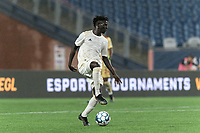 FOXBOROUGH, MA - AUGUST 5: Malick Mbaye #5 of North Carolina FC dribbles during a game between North Carolina FC and New England Revolution II at Gillette Stadium on August 5, 2021 in Foxborough, Massachusetts.