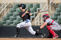 Grant Massey (28) of the Kannapolis Intimidators follows through on his swing against the Hagerstown Suns at Kannapolis Intimidators Stadium on June 15, 2017 in Kannapolis, North Carolina.  The Intimidators walked-off the Suns 5-4 in game one of a double-header.  (Brian Westerholt/Four Seam Images)