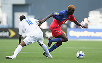 James Marcelin (right) passes Melvin Valladares (18). Honduras defeated Haiti 1-0 during the First Round of the 2009 CONCACAF Gold Cup at Qwest Field in Seattle, Washington on July 4, 2009.