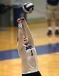 Marymount's Cassidie Watson reaches for a ball during a college volleyball match at Washington & Lee University Lexington, Vir., on Saturday, Oct. 5, 2013.<br /> Photo by Cathleen Allison