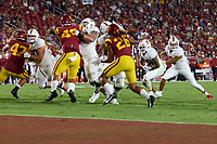 LOS ANGELES, CA - SEPTEMBER 11: Isaiah Sanders #0 hands off to Austin Jones #20 of the Stanford Cardinal during a game between University of Southern California and Stanford Football at Los Angeles Memorial Coliseum on September 11, 2021 in Los Angeles, California.