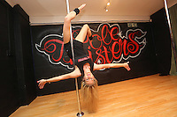Pictured: Sian O'Shea. Saturday 22 February 2014<br /> Re: Eight women have attempted to set a new world record of most people pole dancing at the same time.<br /> Pole 4 Life world record attempt was organised by Lisa Broughton at her Pole Twisters dance studio in Cardiff.<br /> The women had to pole dance for six minutes to set the new record.
