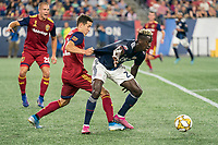 FOXBOROUGH, MA - SEPTEMBER 21: Aaron Herrera #22 of Real Salt Lake and Wilfried Zahibo #23 of New England Revolution compete for the ball in the Real Salt Lake penalty box. during a game between Real Salt Lake and New England Revolution at Gillette Stadium on September 21, 2019 in Foxborough, Massachusetts.