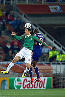 Guillermo Franco (L) of Mexico and Eric Abidal (R) of France