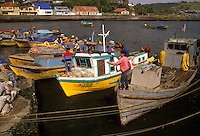 AJ2095, boats, Chile, Chiloe Island, Local fishermen on colorful fishing boats moored in the harbor in Ancud on the Pacific Ocean on Chiloe Island in Chile.