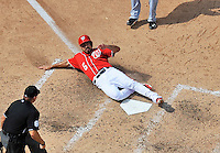 22 June 2014: With Adam LaRoche batting, a wild pitch is thrown by Atlanta Braves pitcher Luis Avilan, allowing Anthony Rendon to slide home and score the Washington Nationals' 4th run against the Atlanta Braves at Nationals Park in Washington, DC. The Nationals defeated the Braves 4-1 to split their 4-game series and take sole possession of first place in the NL East. Mandatory Credit: Ed Wolfstein Photo