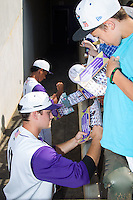 Jason Coats (17) of the Winston-Salem Dash signs autographs prior to the game against the Wilmington Blue Rocks at BB&T Ballpark on July 6, 2014 in Winston-Salem, North Carolina.  The Dash defeated the Blue Rocks 7-1.   (Brian Westerholt/Four Seam Images)