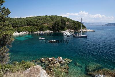 Greece, Corfu, near Agni: View over rocky cove and boats on islands North East coast