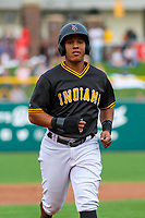 Indianapolis Indians outfielder Christopher Bostick (7) jogs to the dugout during an International League game against the Buffalo Bisons on July 28, 2018 at Victory Field in Indianapolis, Indiana. Indianapolis defeated Buffalo 6-4. (Brad Krause/Four Seam Images)