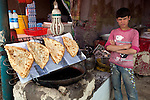13 June 2013, Onaba Village, Onaba District, Panjshir Province,  Afghanistan.   Traditional fried bread filled with potatoes on sale at a roadside stall between Panjshir and Kabul. Picture by Graham Crouch/World Bank
