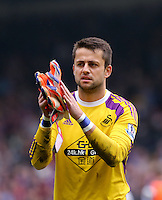 Pictured: Lukasz Fabianski of Swansea thanks away supporters<br />