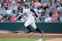 Yoan Moncada (10) of the Charlotte Knights takes off for second base during the game against the Indianapolis Indians at BB&T BallPark on June 16, 2017 in Charlotte, North Carolina.  The Knights defeated the Indians 12-4.  (Brian Westerholt/Four Seam Images)