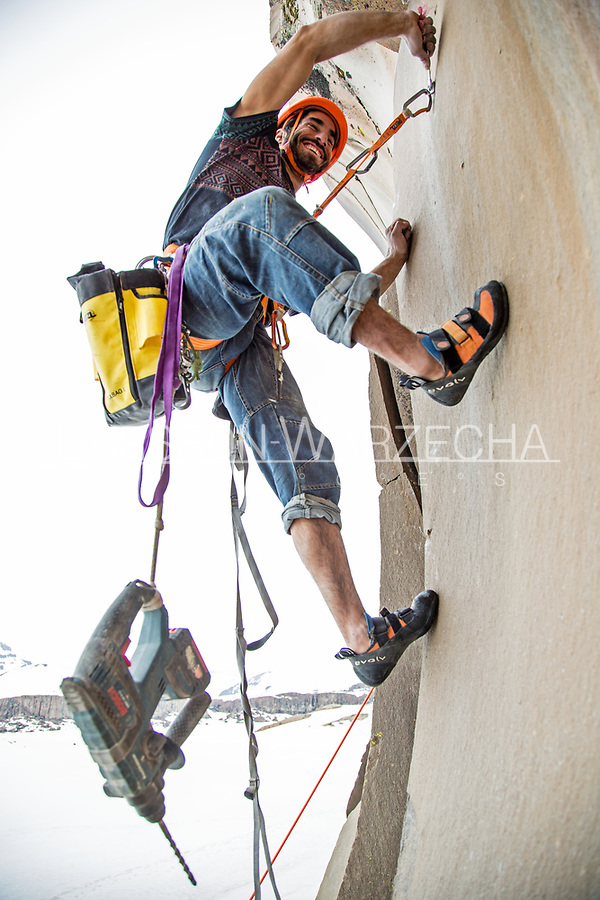 Lucho Birkner bolting a new route at the Gran Pared (main sector), Valle des los Condores, Chile