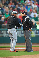 Great Lakes Loons manager Luis Matos (33) argues a call with umpire Brock Ballou during a game against the Dayton Dragons on May 21, 2015 at Fifth Third Field in Dayton, Ohio.  Great Lakes defeated Dayton 4-3.  (Mike Janes/Four Seam Images)