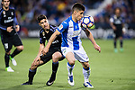 Unai Bustinza (r) of Deportivo Leganes fights for the ball with Marco Asensio Willemsen of Real Madrid during their La Liga match between Deportivo Leganes and Real Madrid at the Estadio Municipal Butarque on 05 April 2017 in Madrid, Spain. Photo by Diego Gonzalez Souto / Power Sport Images